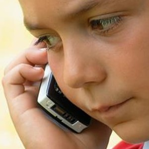 boy with cell phone to ear